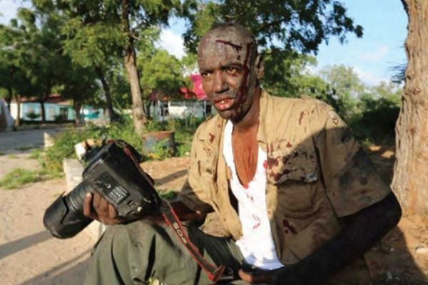 Wounded photographer In the Eye of the Storm Journalists' commemorative service