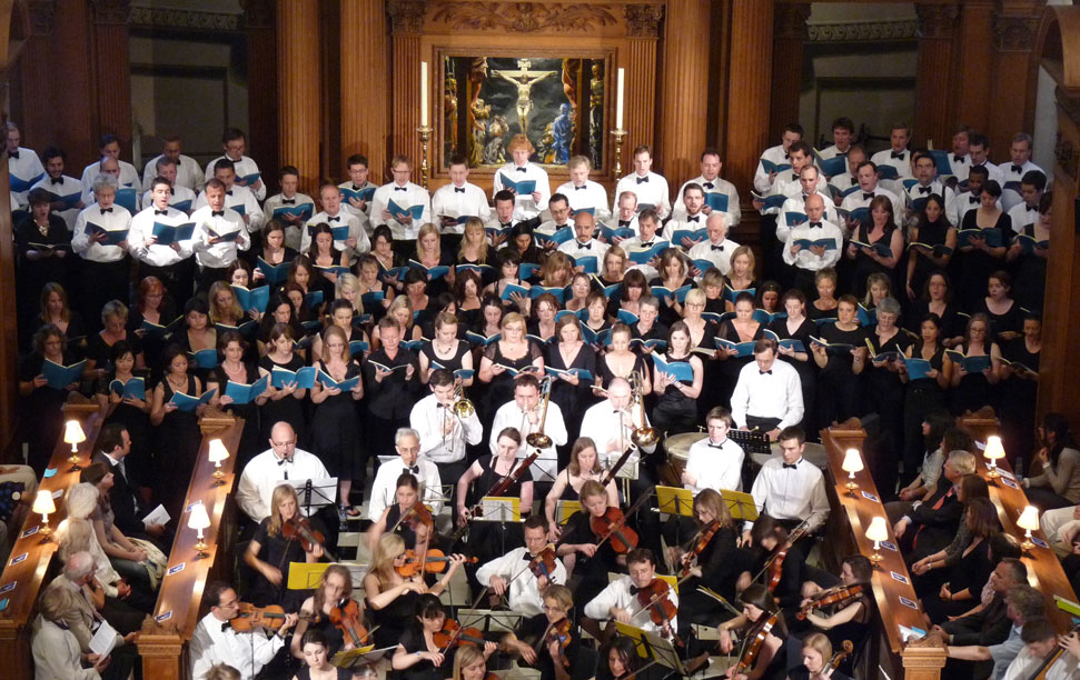 EC4 Music choir and Orchestra performing a concert at a packed St Bride's