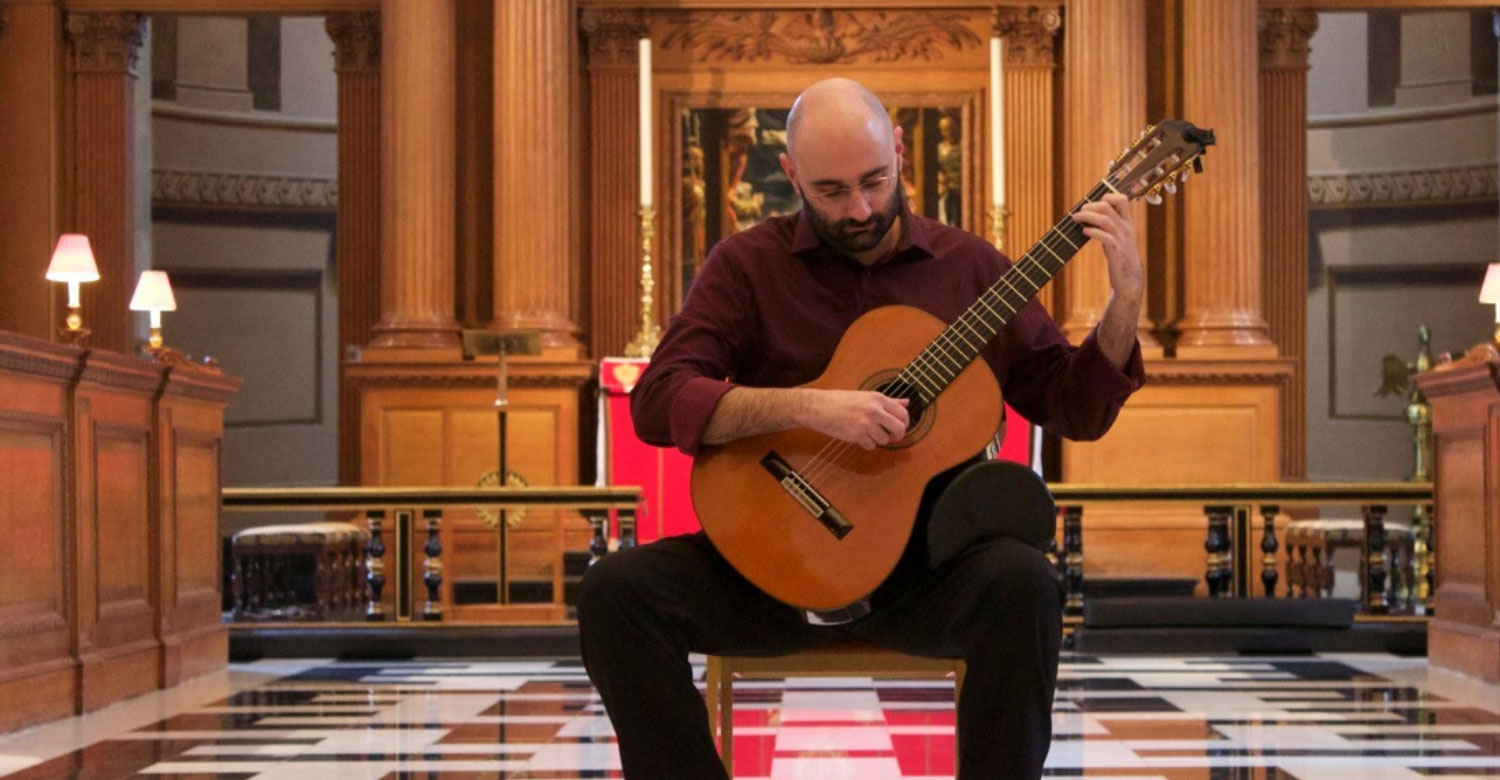 Guitarist Stelios Kyriakidis playing in front of St Bride's altar
