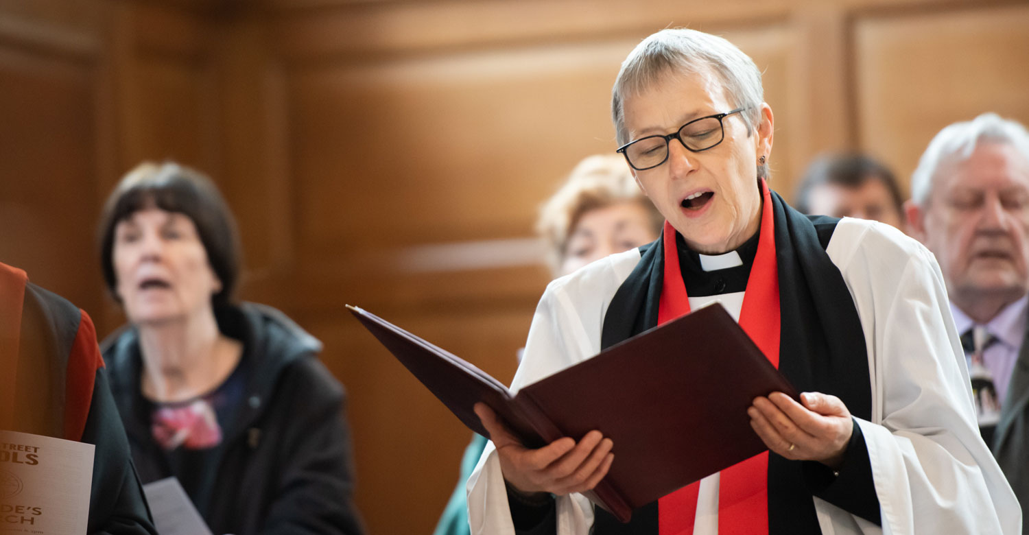 Rector singing hymn in a service