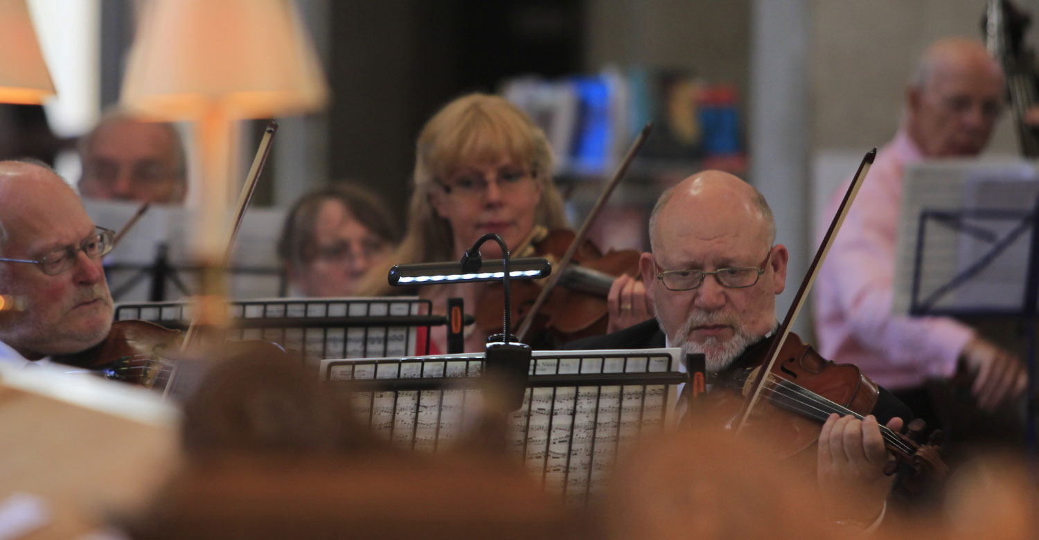 violinists playing in orchestra at St Bride's