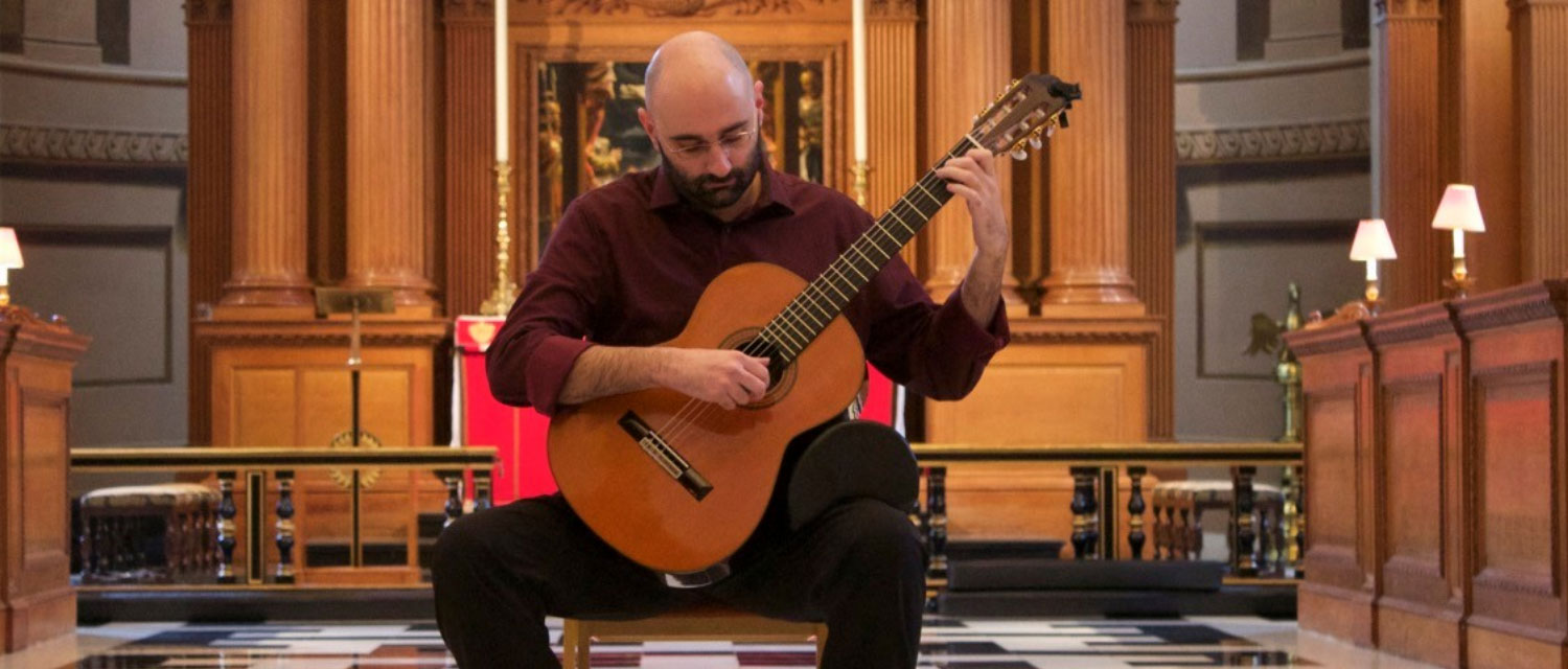 Guitarist Stelios Kyriakidis playing in front of the altar of St Bride's