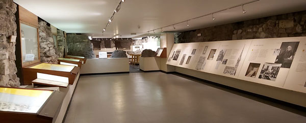 crypt museum display cases and information panels