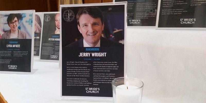 Jerry Wright memorial plaque next to candle