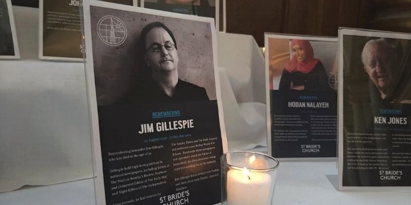 Memorial plaque for Jim Gillespie next to candle