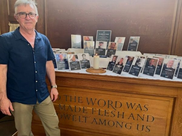 John McCarthy stands in front of Journalists' Altar at St Bride's
